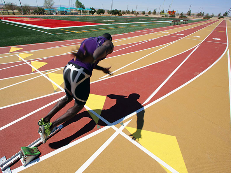 man running on mondo track